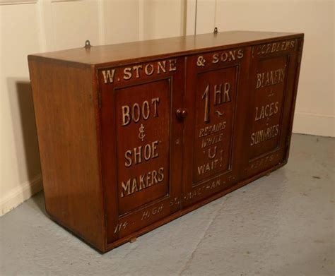 boot and shoe makers shop cupboard shop display