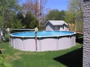 piscine hors terre avec drain de fond 24 et patio en bois