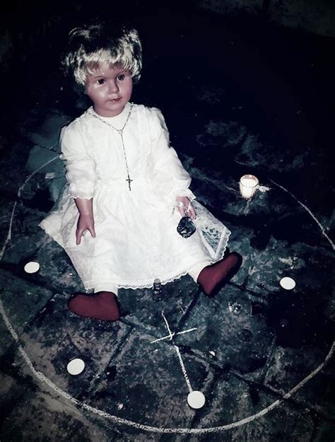 frozen doll haunted possessed doll causes who look at it to suffer