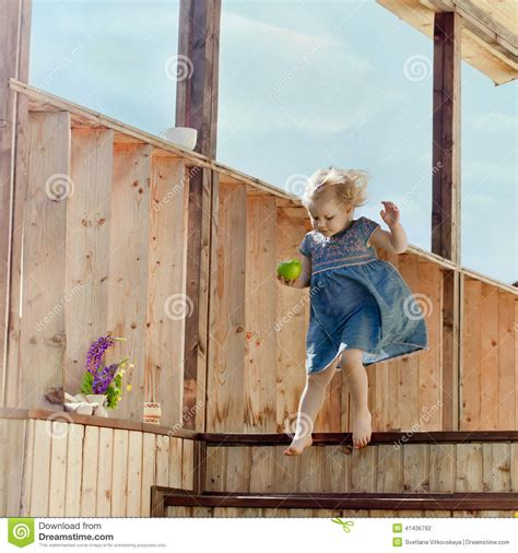 little girl house little girl jumping on a country house stairs stock photo image 41436792