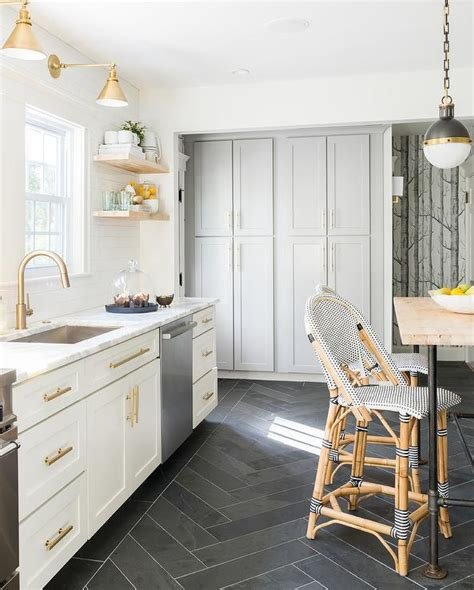 white kitchen cabinets tile floor white and gold kitchen with black herringbone floor tiles