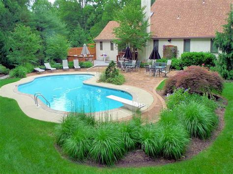landscaped backyards with pools nice idea for inground pool landscaping the best
