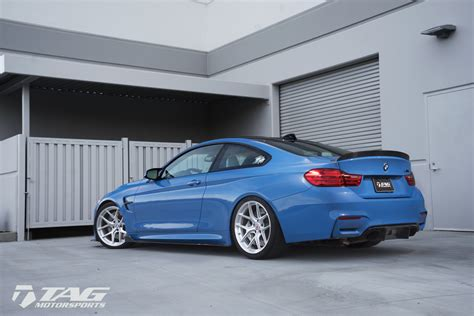 yas marina blue bmw m4 with hre wheels