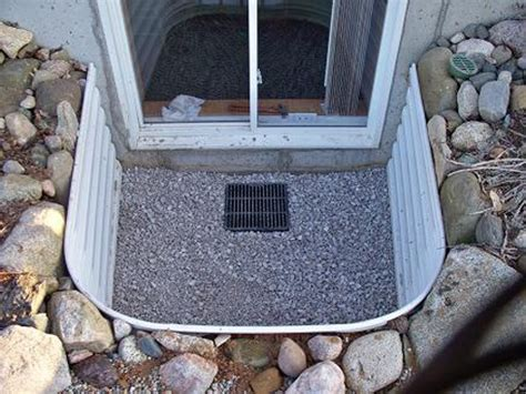 how to install a basement window well how to install a well to stop window well flooding