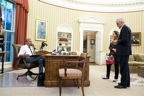 obama s oval office file president obama on the phone in the oval office with