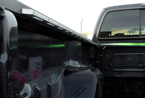truck bed rail system inside bed rail
