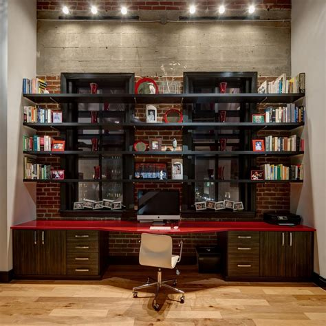 home with exposed brick and photos hgtv