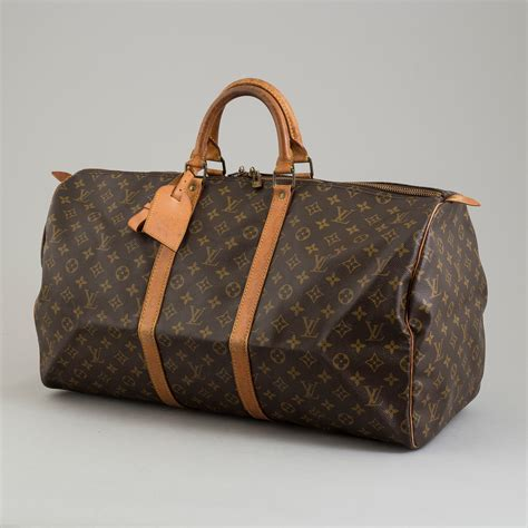 louis vuitton  monogram canvas keepall  weekend bag
