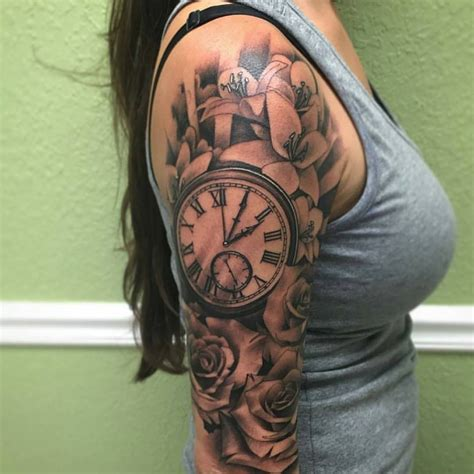 clock tattoo with roses grey flowers and clock on right half sleeve by