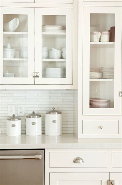 white kitchen glass backsplash linear white glass tiles transitional kitchen ashlee