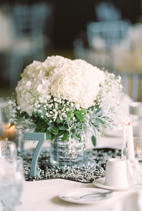 babys breath and white hydrangea centerpiece white