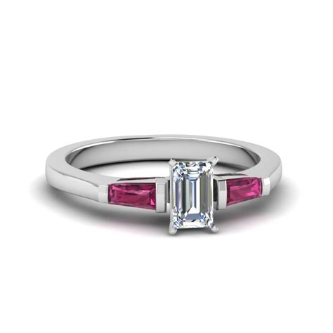 emerald cut 3 ring with pink sapphire baguette in