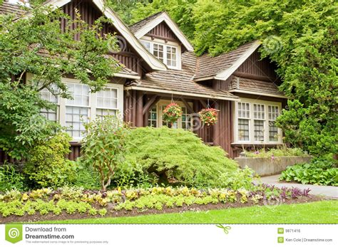 Free Cabin Plans landscaped log cottage in woods royalty free stock image