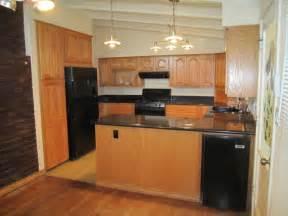 Beautiful black granite slab counter tops ample oak cabinetry deep