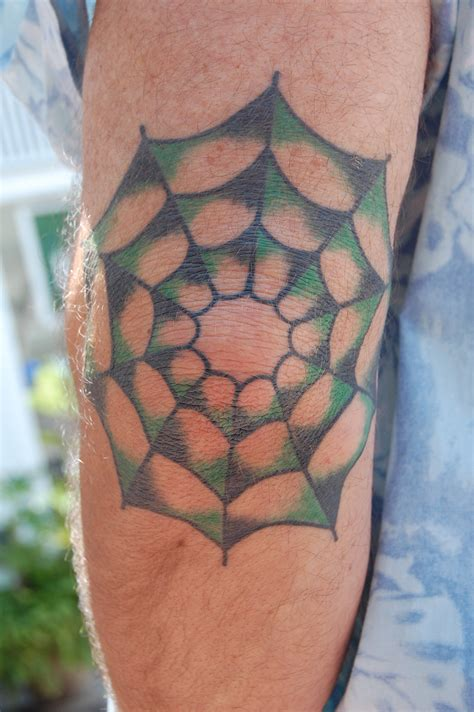 tattoo on elbow spiderweb tattoos