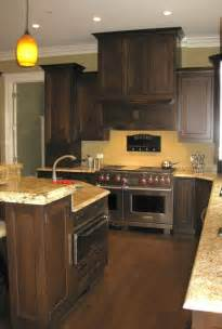 Beside yellow tones will look good with dark wood cabinets and floors