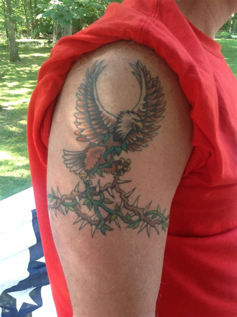 vine tattoo on chest eagle on thorny vine tattoo cross in eagle s chest