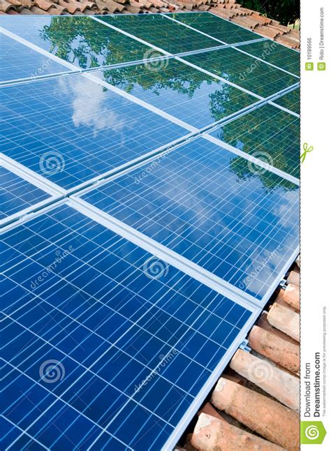 solar panels on roof with green reflection royalty free