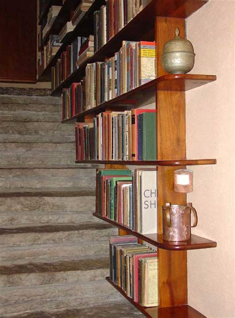 stairway bookshelves storage for small spaces the tiny
