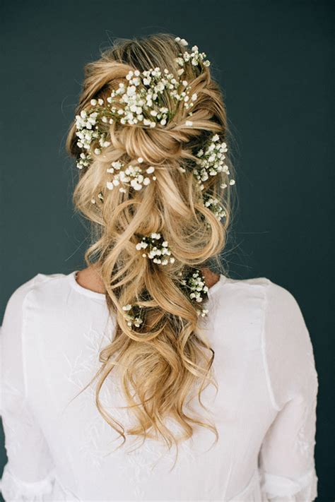 wedding hairstyles front and back views romantic tousled bridal braid adorned with baby s breath