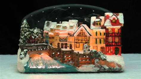 christmas village house with santa claus on a sleigh led