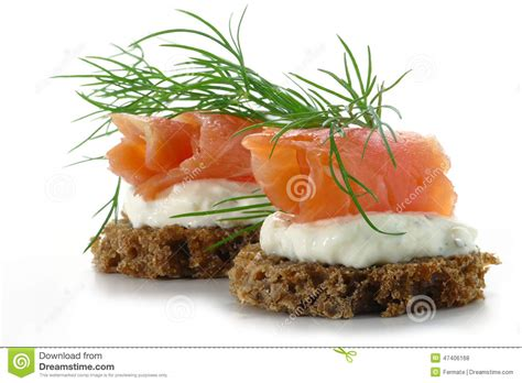 fresh canapes two salmon canapes with fresh dill garnish isolated on