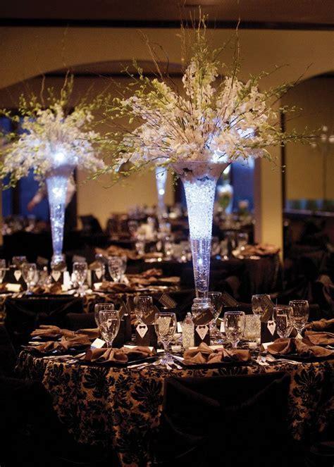 Tall Wedding Centerpieces   But with a Deep purple light