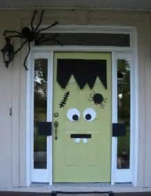 Decorating Door For Halloween It S Written On The Wall Halloween Wreaths Ghosts Trees