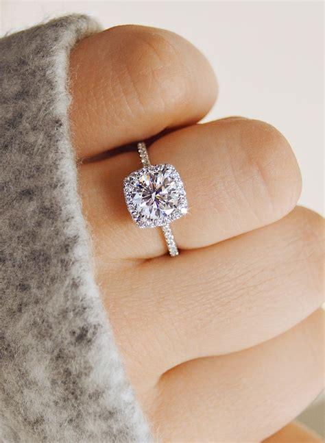 delicate cushion shaped halo engagement ring by