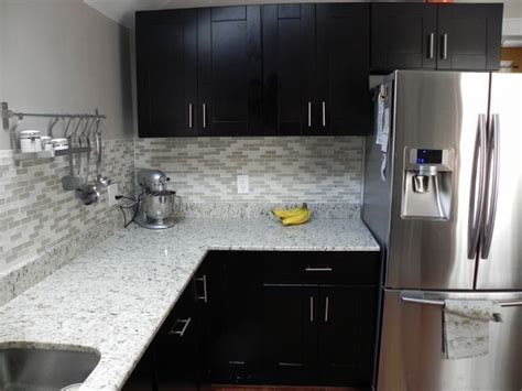tile backsplash with mocha shaker cabinets shaker
