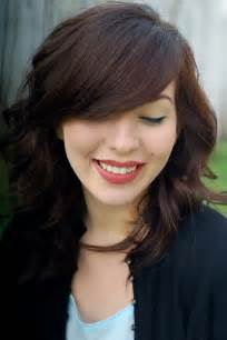 side swip layered haircuts with side swept bangs for thick hair 1