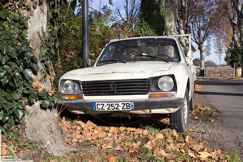 peugeot 504 pickup peugeot 504 pick up with more patina than rust drive by