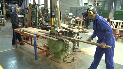 woodworking factory wood cutting with electric saw in factory workshop