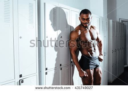 In The Locker Room by Athlete Exercise Biceps Barbell Stock Photo