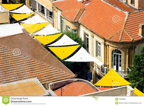 House Plans Mediterranean Aerial View On Small Street With Sun Protective Shades In