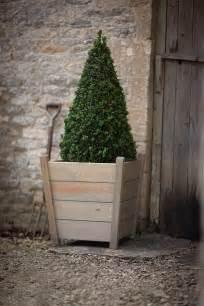 large kingham wooden planter at garden trading