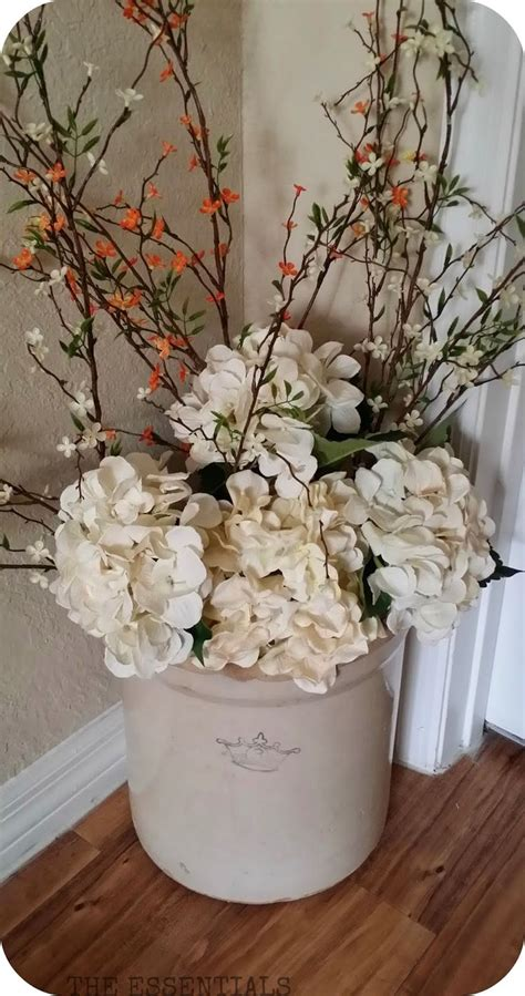 Decorating With Crocks by Dress Up And Crock With Flowers For The Season Home