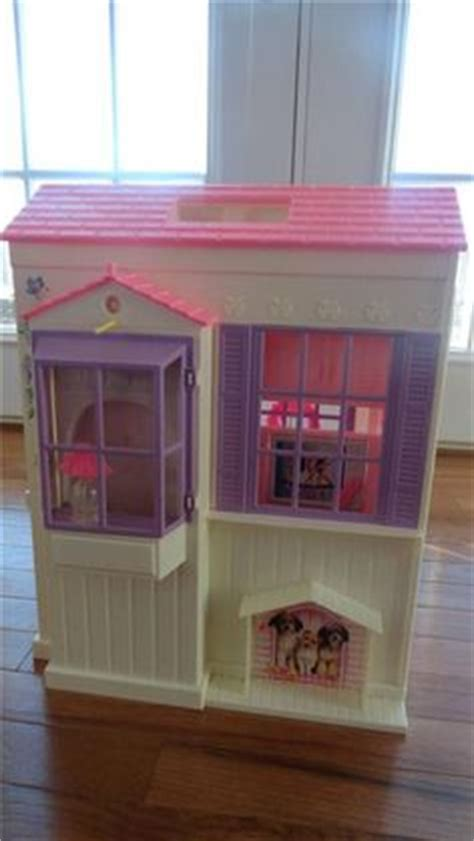 barbie folding doll house barbie dollhouses on pinterest barbie dream house barbie and dollhouses