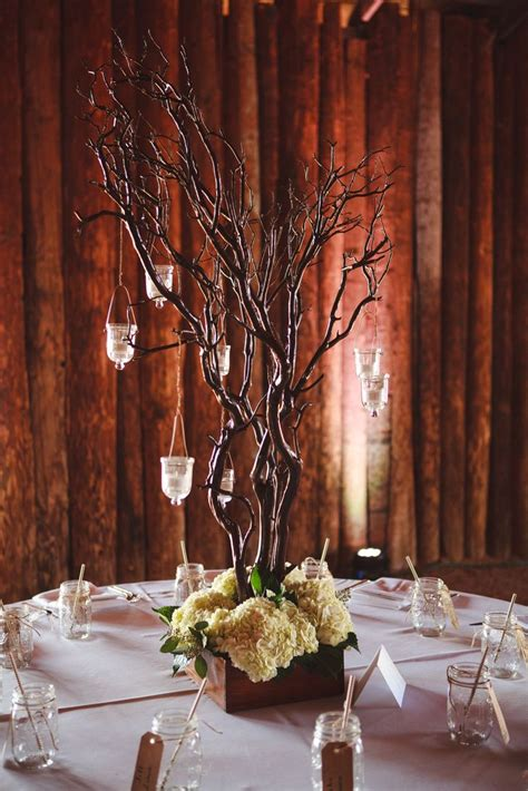manzanita branch centerpieces with hanging candles