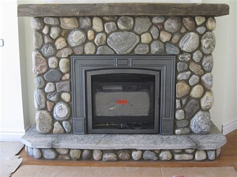 valor gas fireplace with river stone efficient wood gas