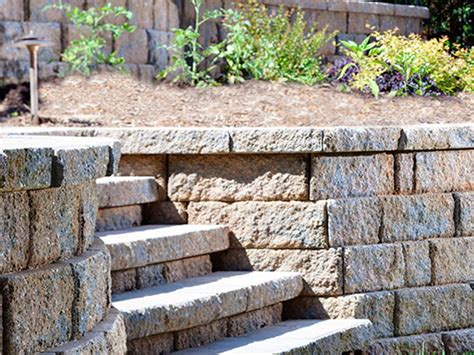 building a paver patio with retaining wall paver retaining walls landscape services