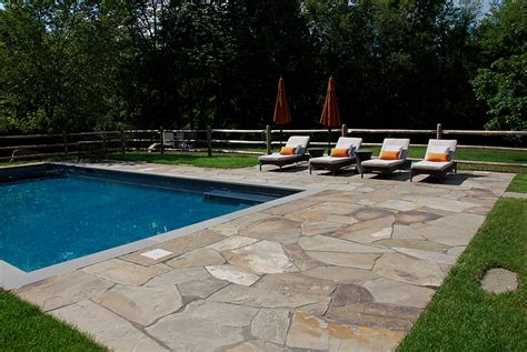 patio installation cost how much does it cost to build a patio in new york comparing the cost of pavers concrete and