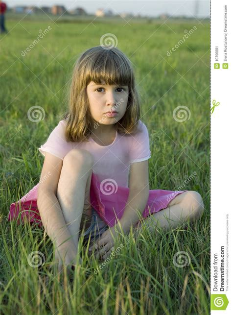 tiny small upset sitting in grass stock image image 10796881