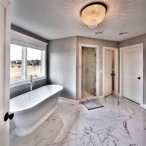 bathroom window spy master bathroom tile floor freestanding tub overlooking window hidden toilet and