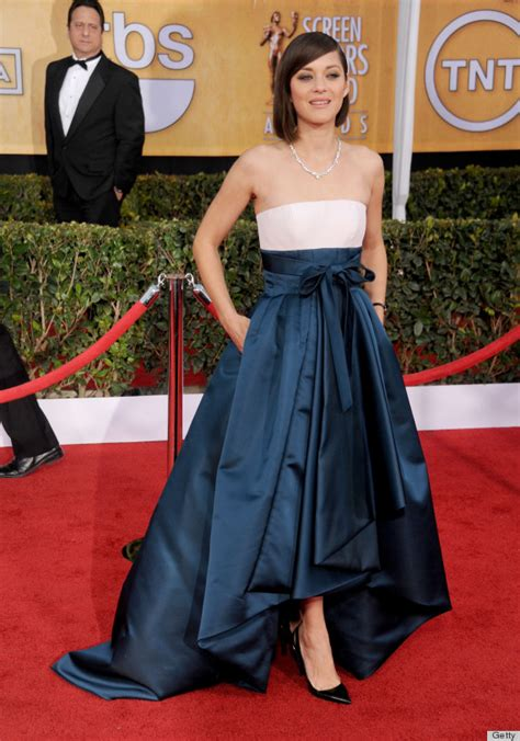the hottest red carpet styles are those women age 60 and marion cotillard wears our favorite red carpet style
