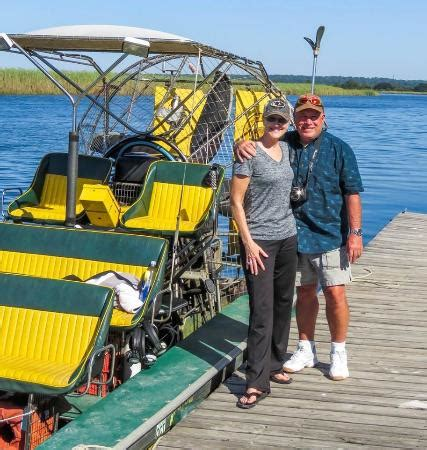 us by the boat picture of airboat express tours - Fan Boat Tours Mobile Al