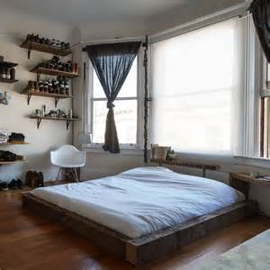 Frame For Bed On The Floor Well Organized Masculine Bedroom Combined With A Closet Digsdigs