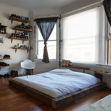 on floor bed frame well organized masculine bedroom combined with a closet