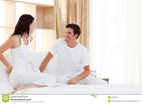 fun in bed romantic couple having fun on their bed royalty free stock