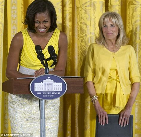 what is the gold curtain behind obama ouch that s bright michelle obama and jill biden co